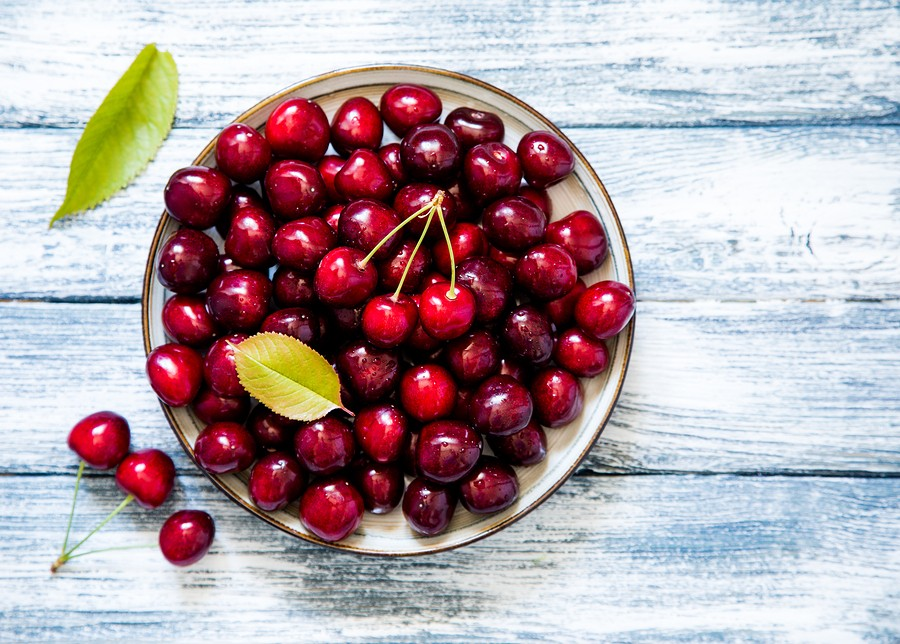 Fresh Cherry On Plate On Wooden Blue Background. Fresh Ripe Cherries. Sweet Cherries