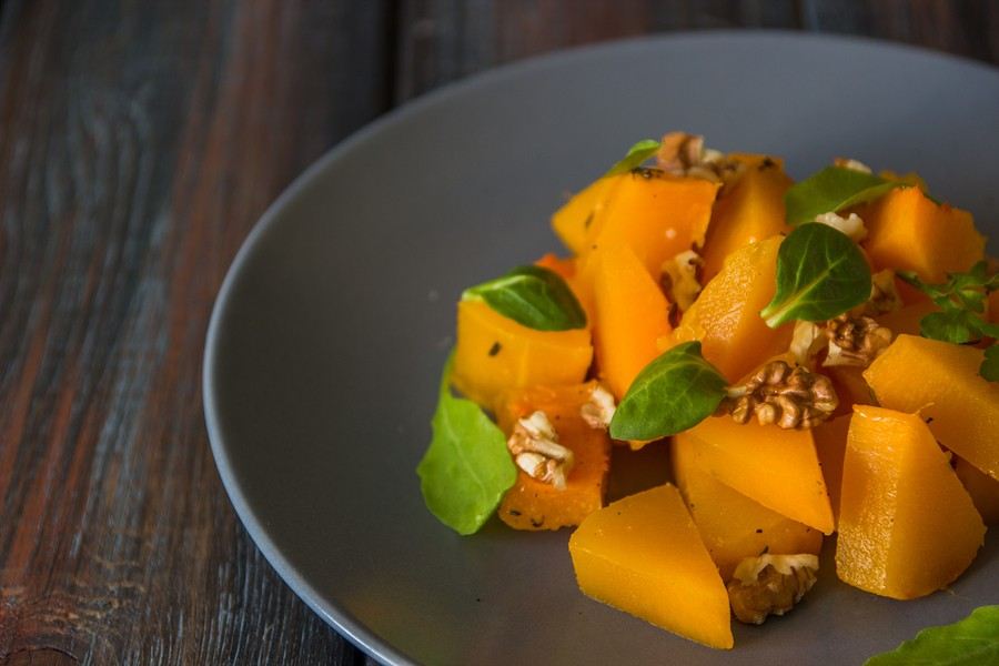 Salad With Pumpkin, Walnuts And Green Leaves