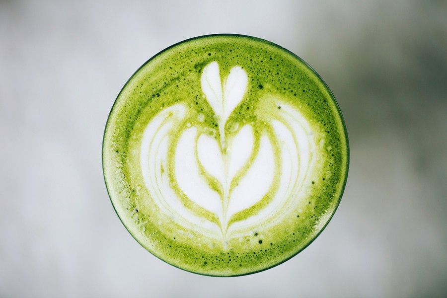 Trendy Green Latte, Macro. Avocado Or Matcha Foam With Latte Art.