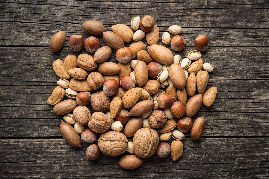 Different types of nuts in the nutshell. Hazelnuts, walnuts, almonds, pecan nuts and pistachio nuts