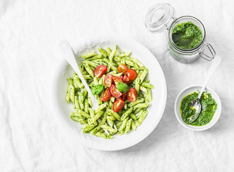 Pasta Penne With Arugula Pesto And Cherry Tomatoes On Light Background, Top View
