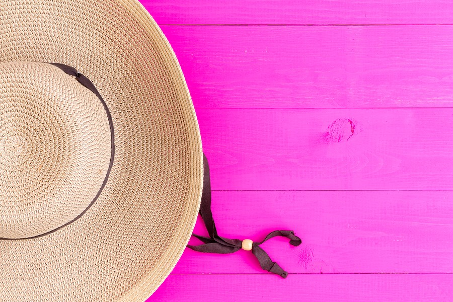 Straw Sunhat On Vibrant Pink Background