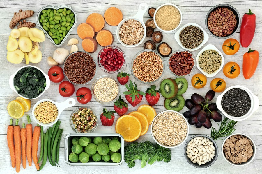 Fresh super food concept with fruit, vegetables, grains, cereals, pulses, seeds, herbs and spice. Fo
