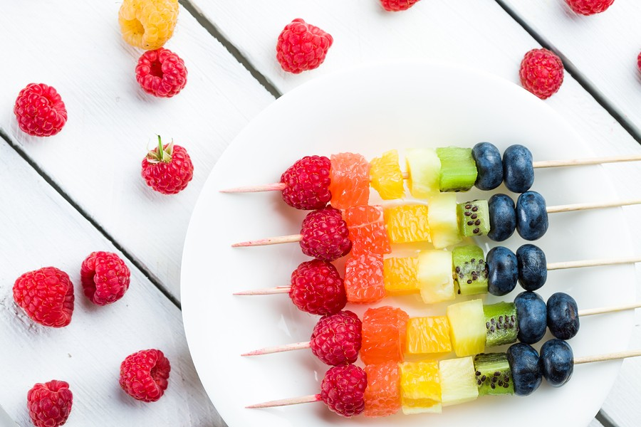 Coloerd Fruits And Berries Kebab On Wooden Table. Studio Shot